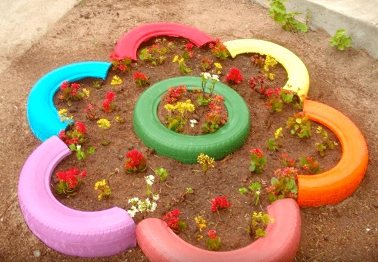 Поделки из шин : клумбы, вазоны, цветочники, садовые фигуры, мебель 55